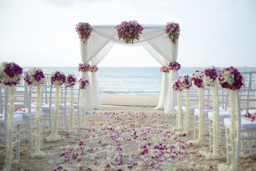 Bringing a stash of flip flops to a beach wedding is sure to be appreciated by your guests