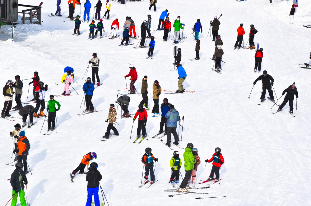 View of skiers on a mountain in Whistler, Canada