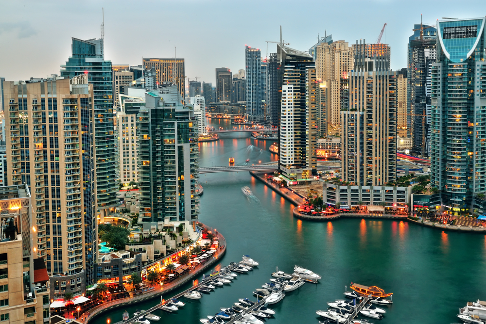View of yachts, moored in Dubai's marina, at sunset