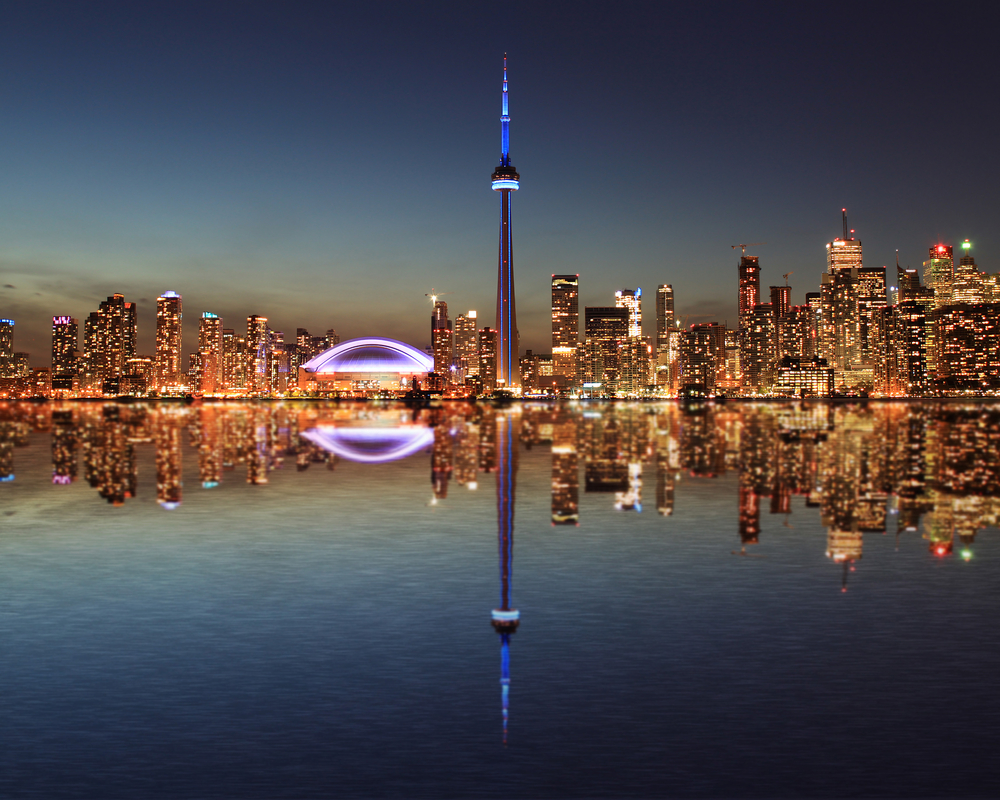 View of Toronto sky line reflected in the waters of Lake Ontario