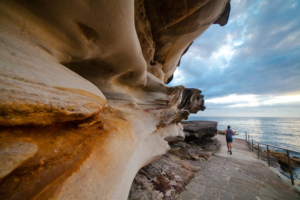 Jogger on a trail near Bondi Beach in Sydney, Australia