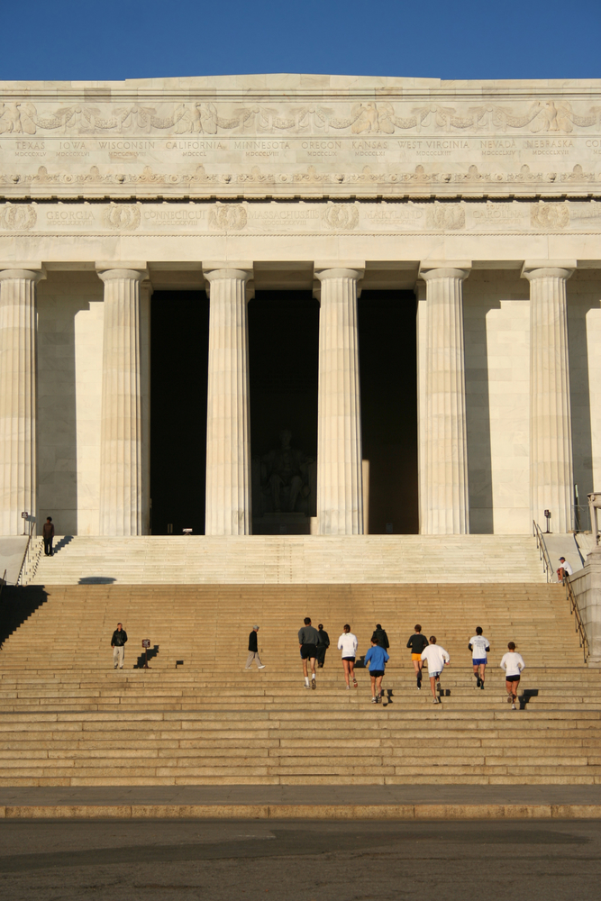 Joggers on the steps of the Lincoln Memorial in Washington D.C.