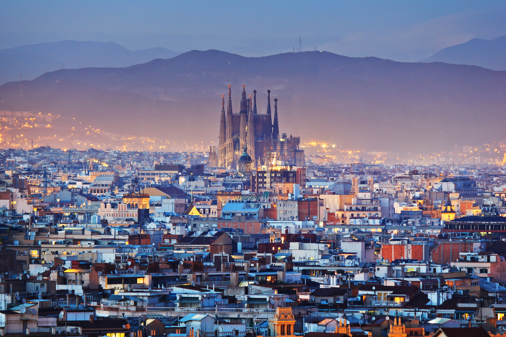 View of Sagrada Familia in the distance at dusk in Barcelona, Spain