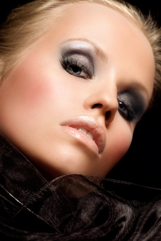European woman with smokey eye makeup