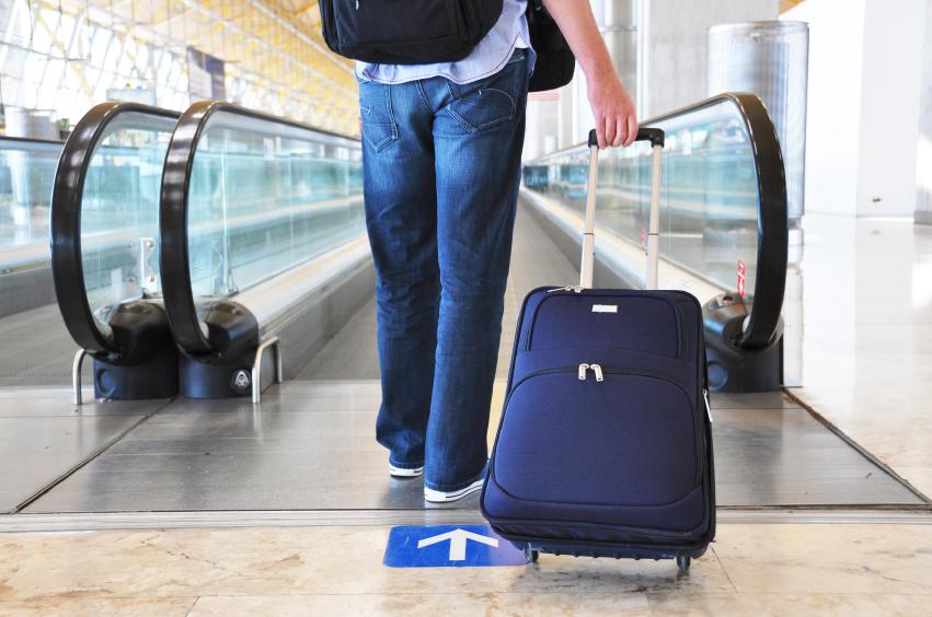 Traveler with a bag at the speedwalk