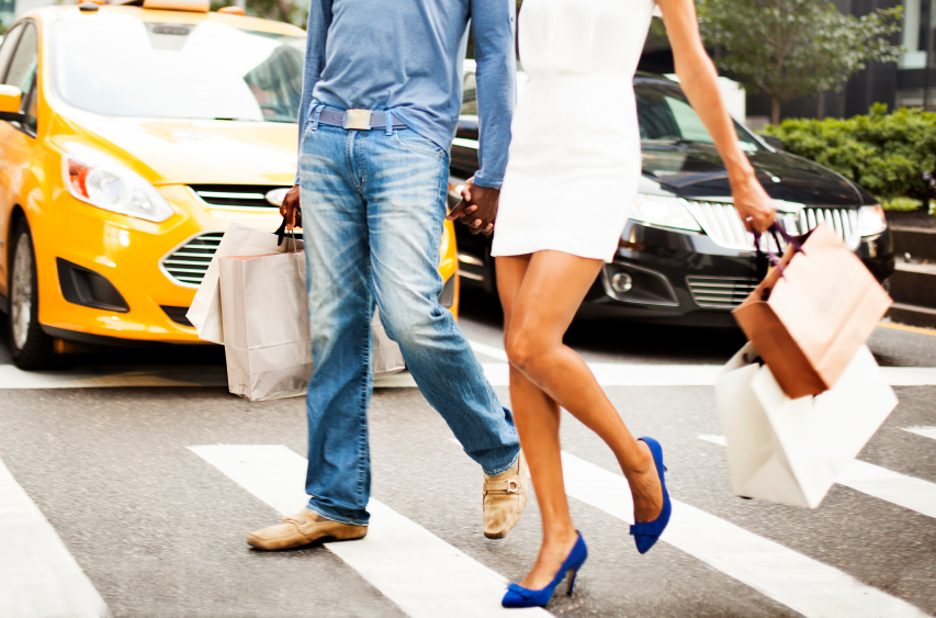 Fashionable couple doing luxury shopping in NY