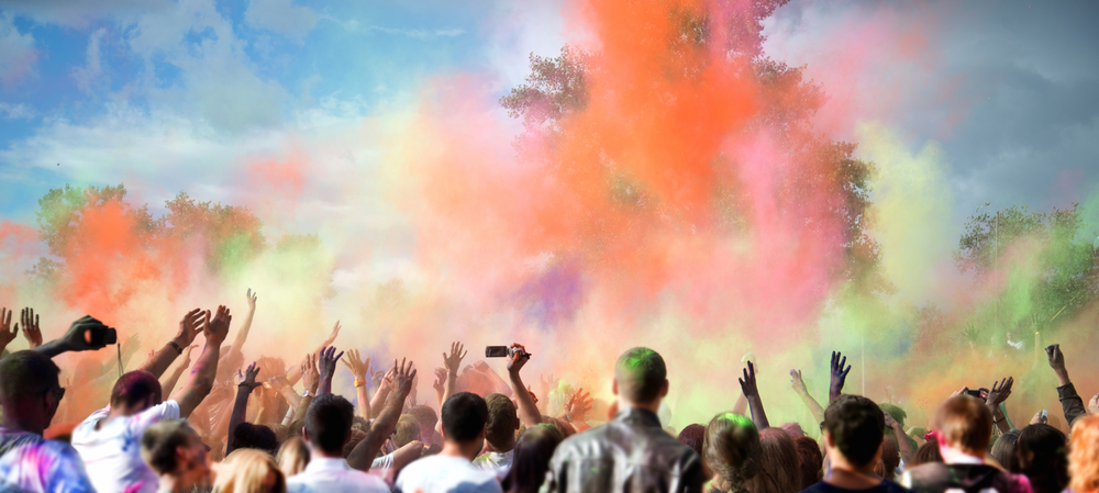 People dancing during the color festival Holi