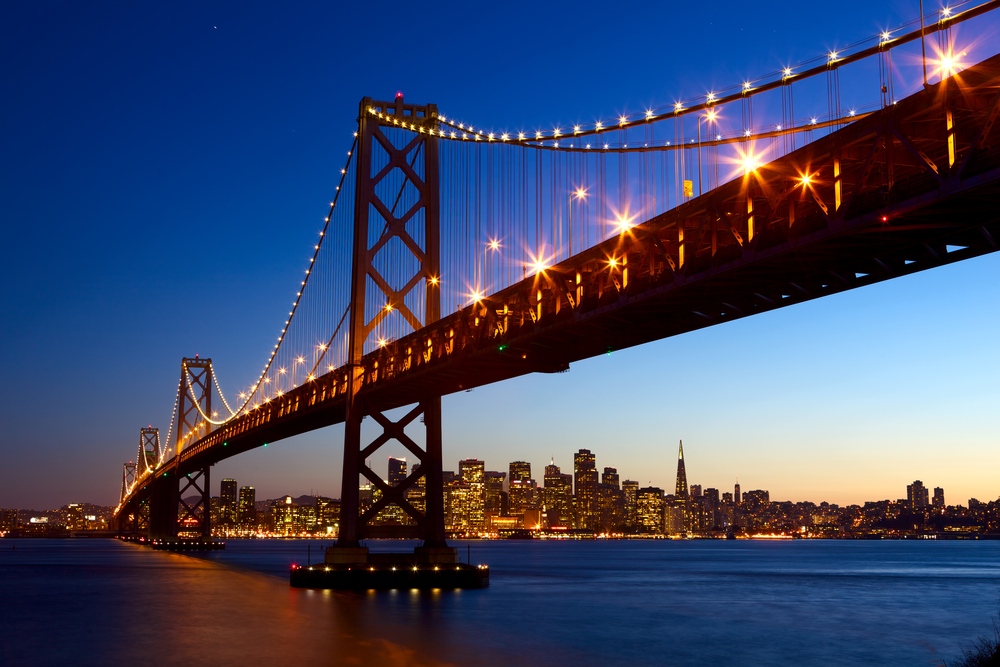 Sunset views of the San Francisco skyline and the Bay Bridge.