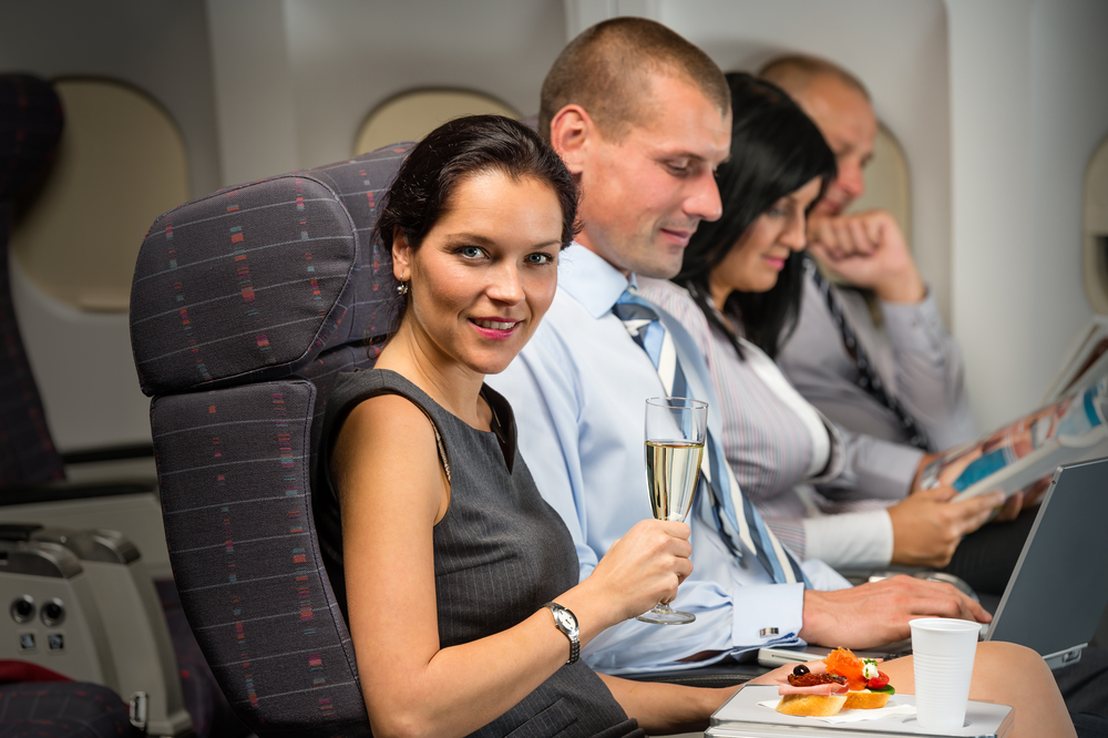 Couple having a meal in an aircraft.