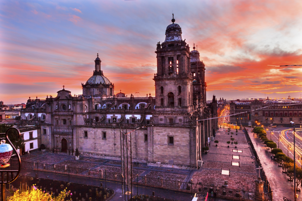 Sunrise views of the Metropolitan Cathedral and President's Palace Mexico City.