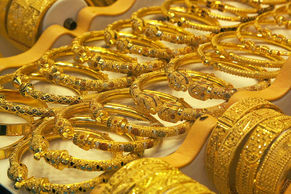 Gold jewelry displayed in a gold souq in the Middle East.