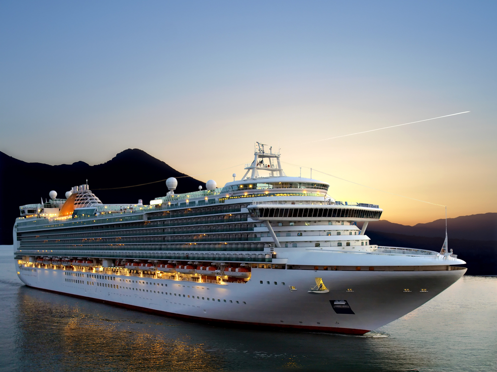 Image of a  luxury cruise ship taken during sunrise.