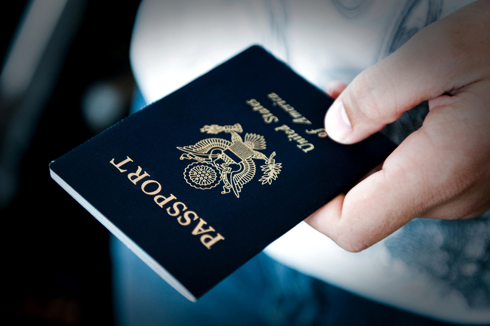 Man holding an American passport