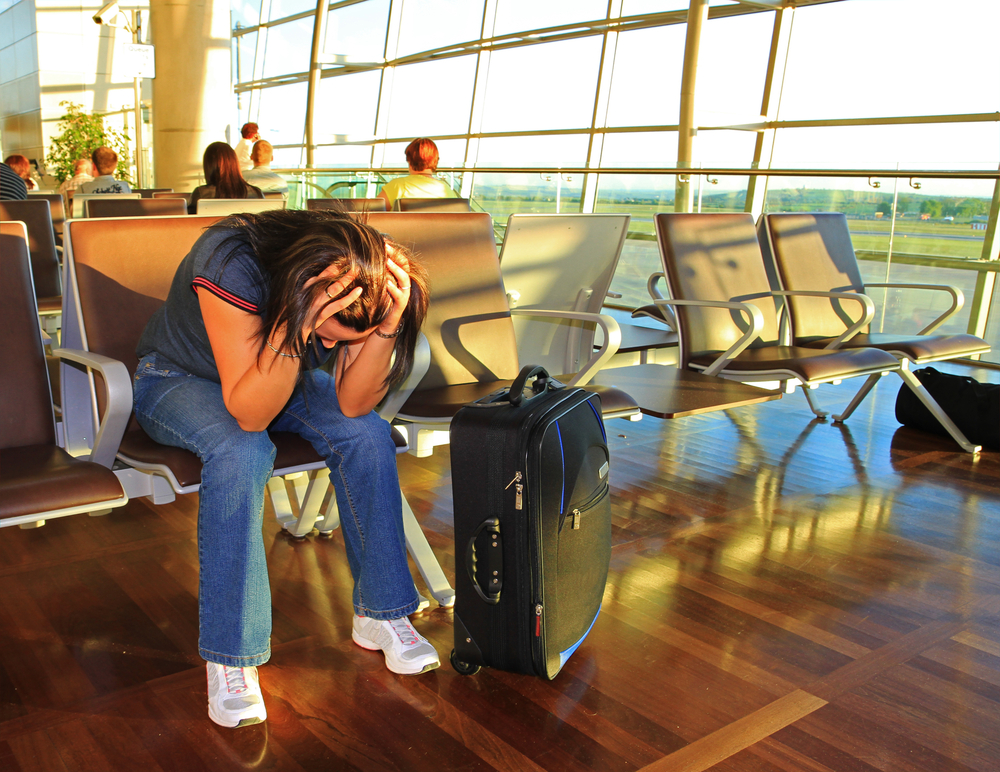 Depressed woman sitting in an airport.