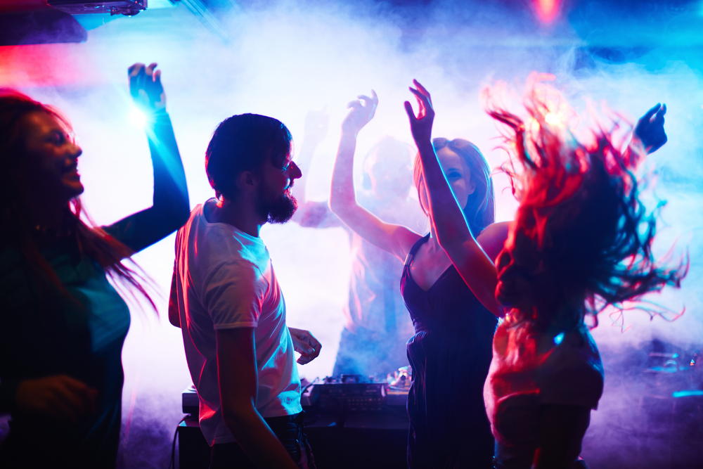 young people dancing in a nightclub.