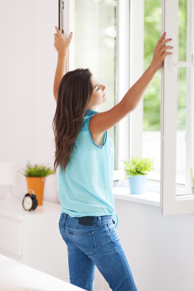Woman opening windows.