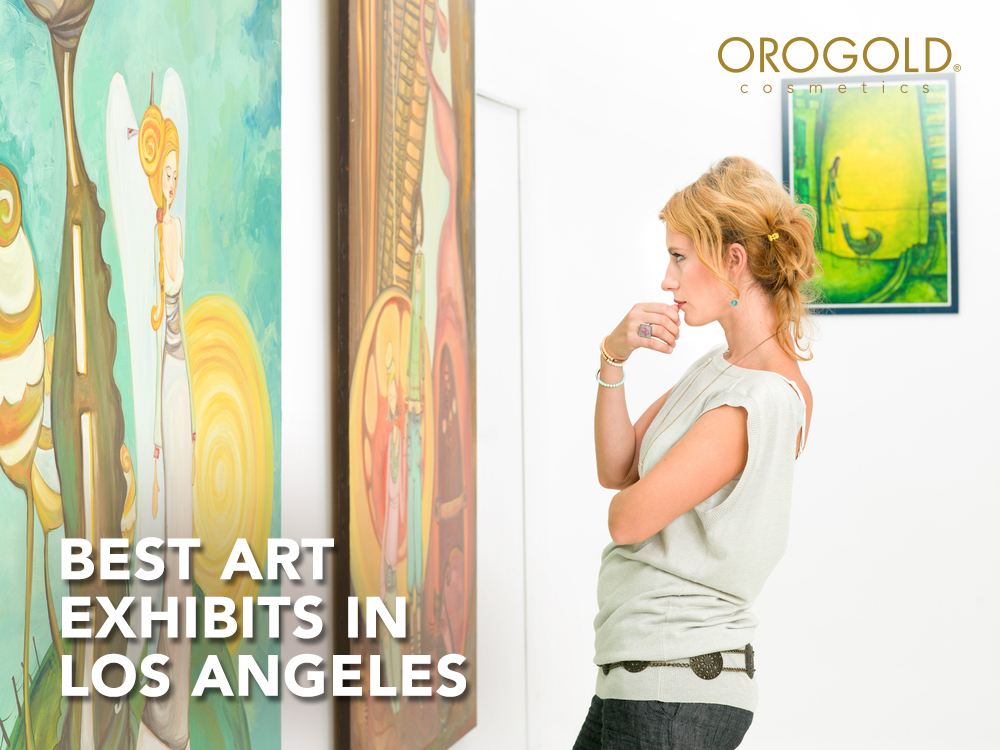 Woman looking at paintings in an art exhibition