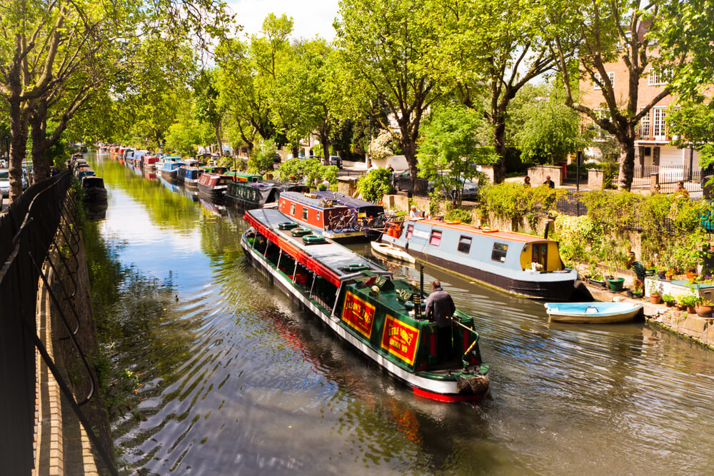 Little Venice, London, England. May 25, 2014. Tourist boat sailing on Regent's Canal and Little Venice, London, England.