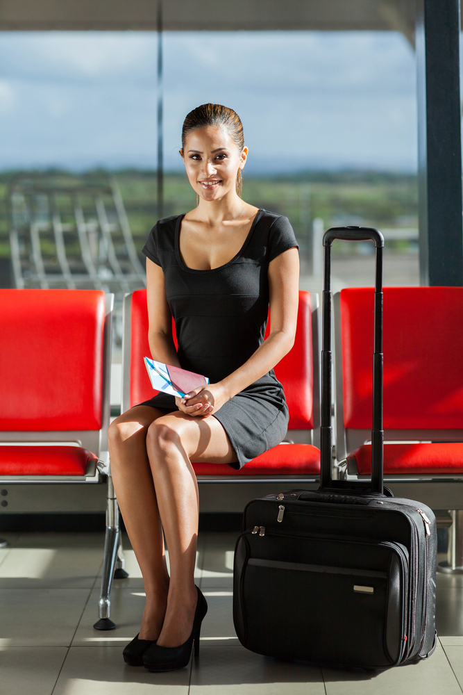 Woman wearing a black dress while traveling