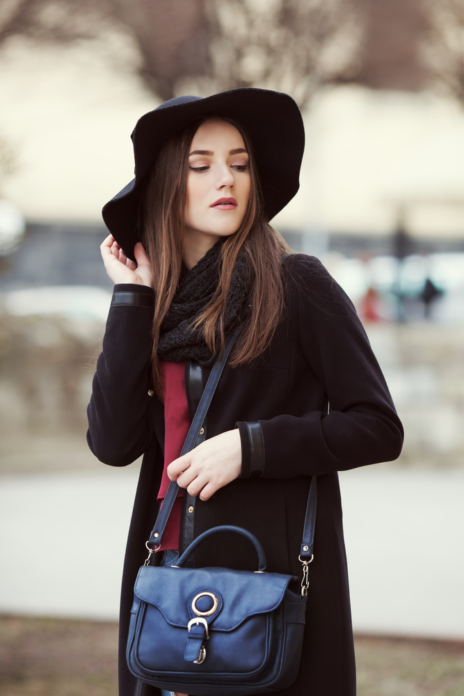 Woman wearing a fedora hat.