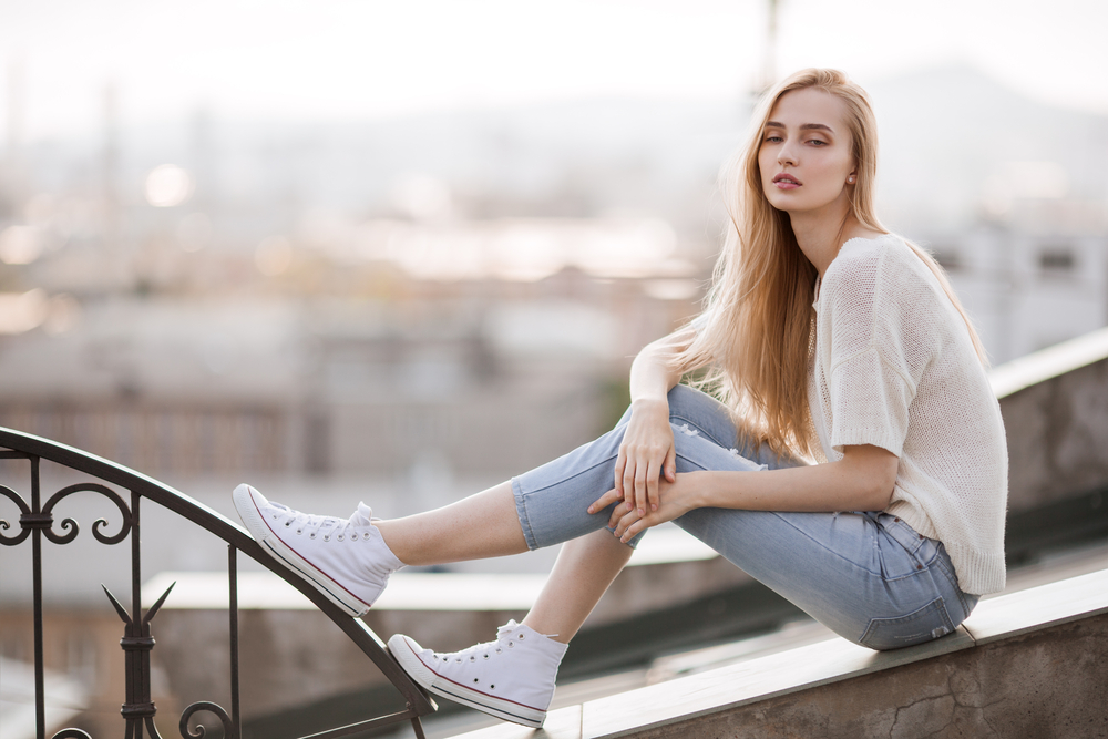 Woman wearing jeans and sneakers