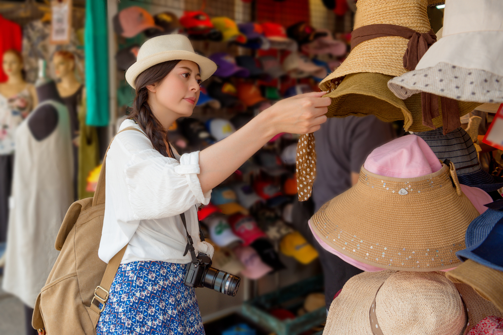 Woman checking out hats