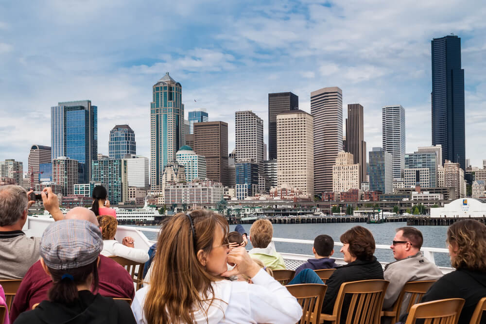 Tourists viewing Seattle from a boat tour