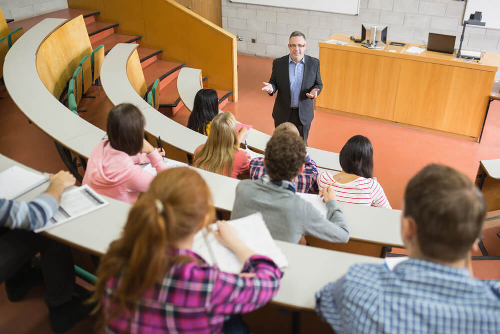 A lecture hall with students and presenter