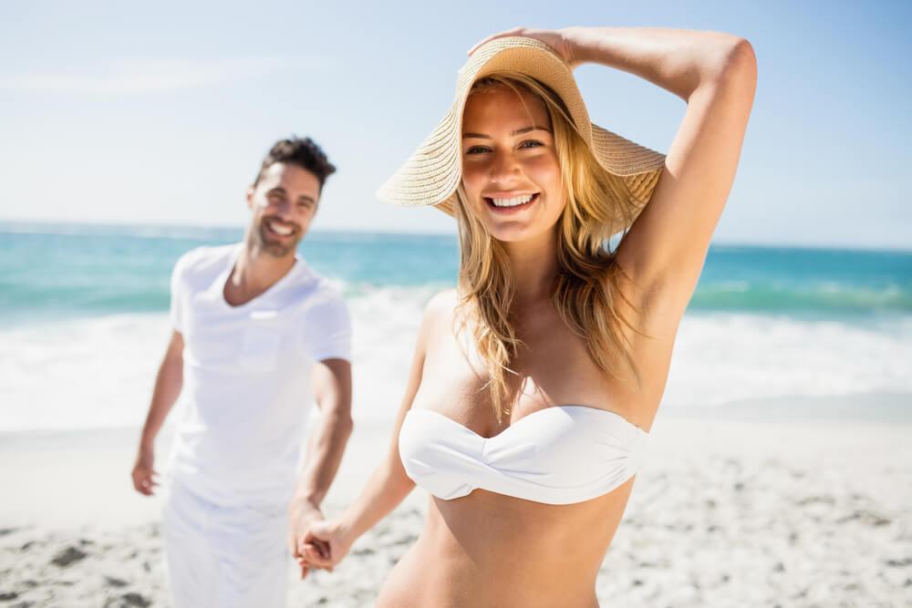 Happy couple on honeymoon at the beach
