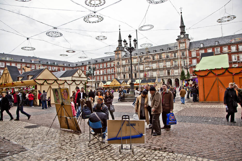 Portrait painters in Plaza Mayor, Madrid, Spain