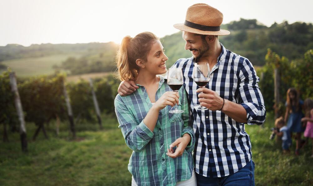 happy couple at vineyard