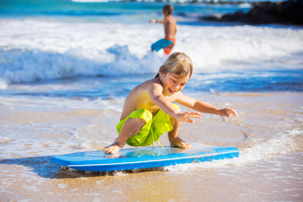Young boy boogie-boarding