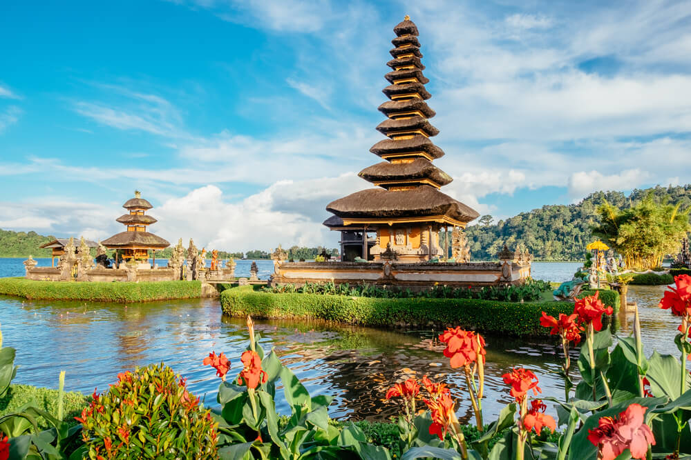 Pura Ulun Danu Bratan temple in Bali island. Hindu temple in flowers on Beratan lake, Asia. Major water temple Bali island, Indonesia. Hindu water temple - culture symbol of Indonesia, Asia landscape