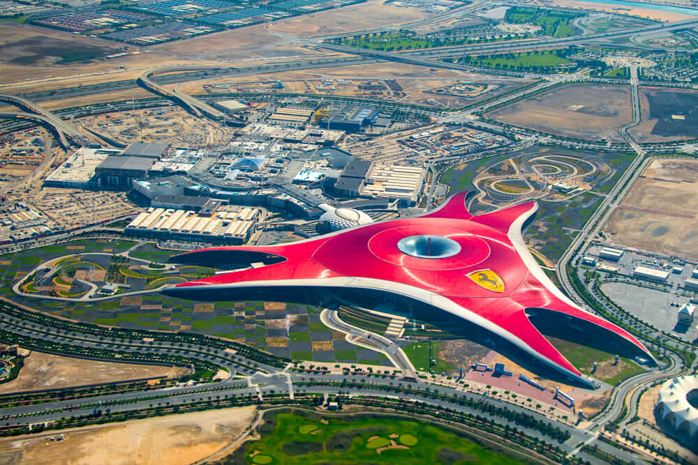 ABU DHABI, UNITED ARAB EMIRATES - MAY 23, 2013: Aerial view of Ferrari World Park is the largest indoor amusement park in the world.
