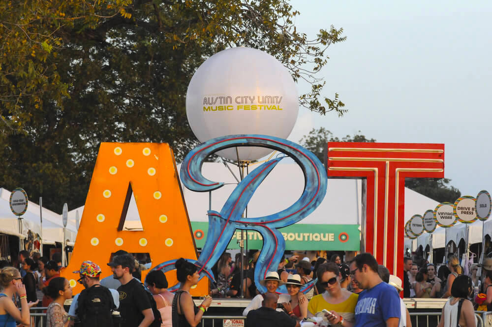 Austin - October 10: Festival goers enjoy an art expo during the Austin City Limits Music Festival on October 10, 2014.
