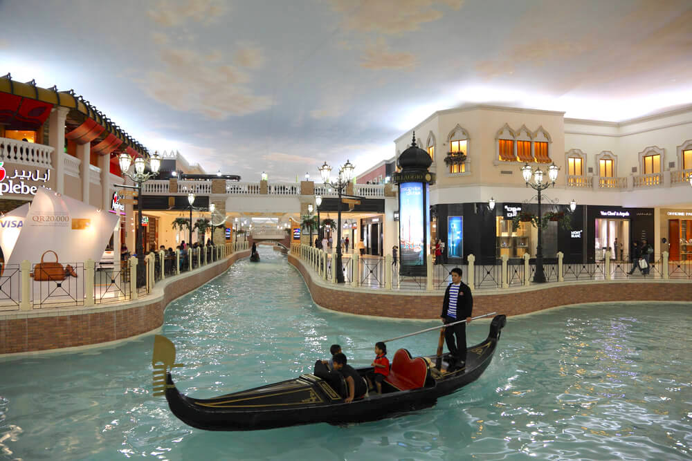 DOHA, QATAR - JAN 7: Canal and Gondola inside of the Villaggio Mall Shopping Center in Doha. January 7, 2012 in Doha, Qatar, Middle East