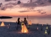 Romantic couple evening dinner on the beach during sunset