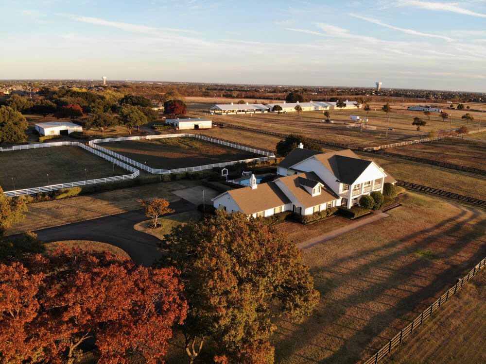 Parker, Texas, United States - November 18 2018: Beautiful Aerial / Drone view of Southfork ranch house during golden hour. The ranch appears in the television series Dallas.