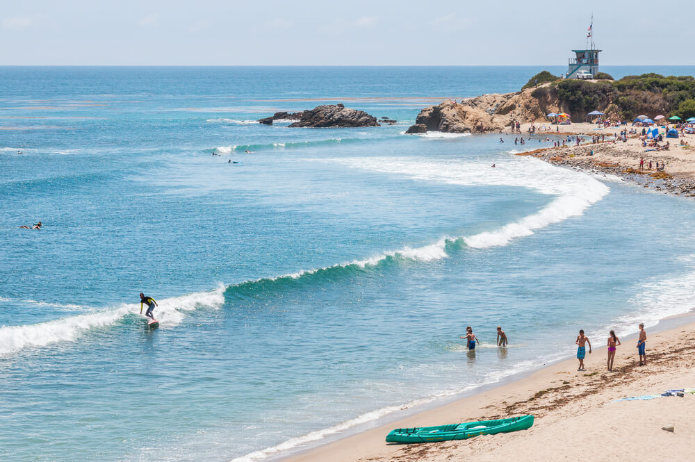 LEO CARRILLO STATE PARK, MALIBU, CALIFORNIA - JULY 22, 2015 - Surfers, swimmers and sunbathers enjoying a summer day in southern California.