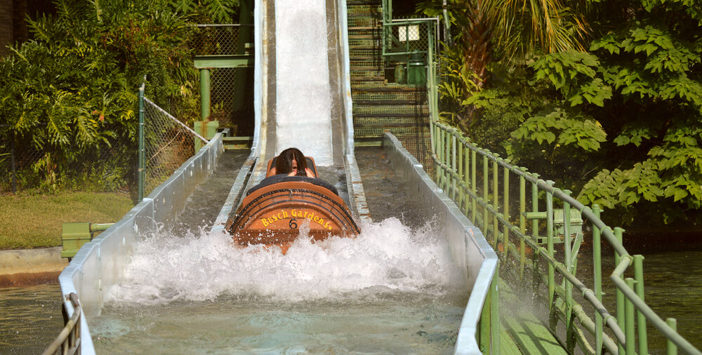 Busch Gardens, Tampa, Florida, USA - October 27, 2016: Tourists on Stanley Falls Log Flume in Busch Gardens Tampa - Stock Image