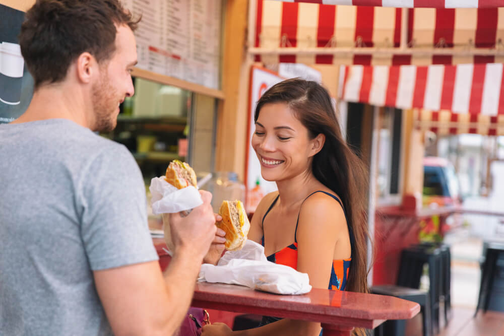A couple enjoying a Cuban sandwich at a cafe in Tampa, Florida